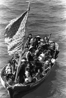 Vietnamese refugees in boat.